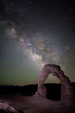 The Milky Way and Delicate Arch in Arches National Park by Dmitri Alexander