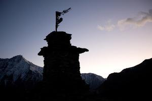 The Silhouette of a Hilltop Stupa Between Manepeme and Til by Dmitri Alexander