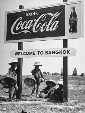 """Billboard Advertising Coca Cola at Outskirts of Bangkok with Welcoming Sign """"Welcome to Bangkok"""" by Dmitri Kessel"""