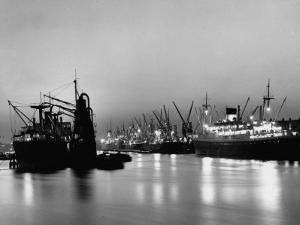 Cargo Ships in the Harbor by Dmitri Kessel