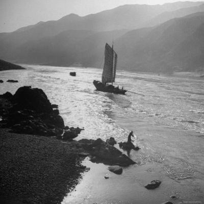 Chinese Junk Boat Sailing Past a Spear Fisherman on the Shore of the Yangtze River by Dmitri Kessel