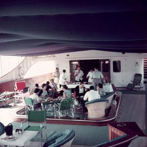 Cocktail Party on Deck of Famous Yacht 'Christina O' Owned by Shipping Magnate Aristotle Onassis by Dmitri Kessel