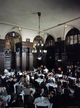 Diners in the Oak Room at the Plaza Hotel by Dmitri Kessel