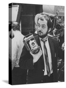 """Film Director Stanley Kubrick Holding Polaroid Camera During Filming of """"2001: A Space Odyssey"""" by Dmitri Kessel"""