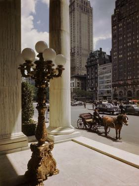 Handsome Cab Horse Drawn Carriage Waiting Outside Entrance of the Plaza Hotel by Dmitri Kessel