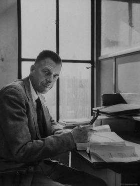 Harvard University Professor John Kenneth Galbraith Sitting in a Harvard Library by Dmitri Kessel