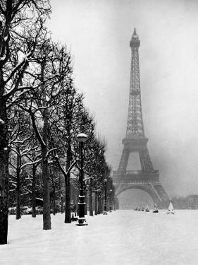Heavy Snow Blankets the Ground Near the Eiffel Tower by Dmitri Kessel