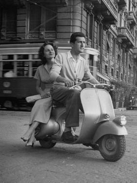 Man and Woman Riding a Vespa Scooter by Dmitri Kessel