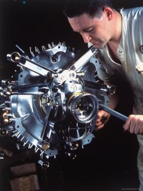 Man Working on Power Section of 'Wasp' Airplane Engine at Pratt and Whitney Aircraft Parts Factory by Dmitri Kessel