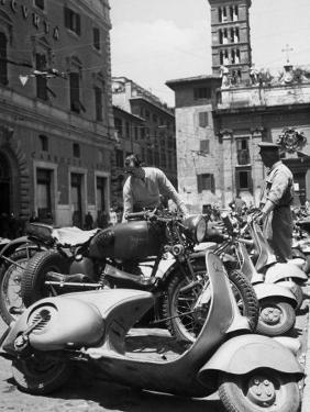 Parking Lot for Vespa Scotters by Dmitri Kessel
