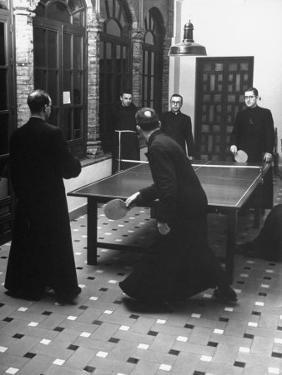 Priests Playing Ping-Pong at Social School by Dmitri Kessel