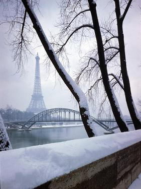 Snowfall in Paris: Passerelle Debilly and Eiffel Tower by Dmitri Kessel