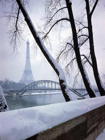 Snowfall in Paris: Passerelle Debilly and Eiffel Tower by Dmitri Kessel