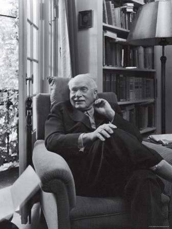 Swiss Psychiatrist Dr. Carl Jung Relaxing in an Easy Chair in His Library at Home by Dmitri Kessel