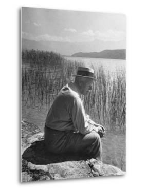 Swiss Psychiatrist Dr. Carl Jung Sitting on Stone Wall Overlooking Lake Zurich by Dmitri Kessel