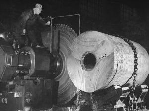 Worker Cutting the Gun Casting in the Bethlehem Steel Factory by Dmitri Kessel