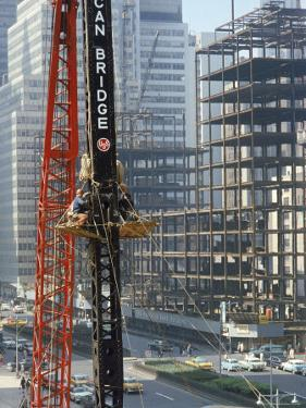 Workers Service Crane Across Street from National Bank Building under Construction on Park Ave by Dmitri Kessel