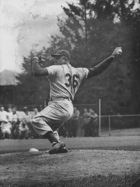 Dodger Don Newcombe Ready to Throw Ball During Game with Braves