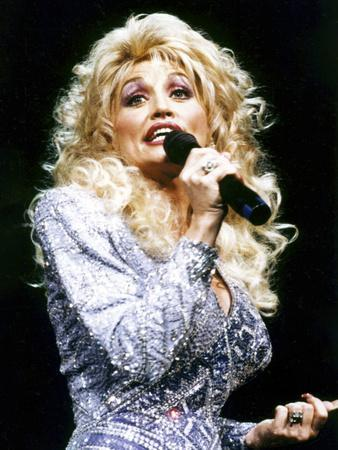 https://imgc.allpostersimages.com/img/posters/dolly-parton_u-L-PRQYSS0.jpg?artPerspective=n