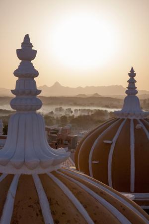 https://imgc.allpostersimages.com/img/posters/domes-of-deogarh-mahal-palace-hotel-at-dawn-deogarh-rajasthan-india-asia_u-L-Q12SBRG0.jpg?p=0