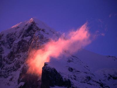 Eiger Mountain Looms in Purple Sunrise Light with Streaking Ridge Clouds, Bern, Switzerland by Dominic Bonuccelli