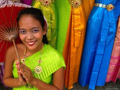 Girl Selling Dresses and Costume Materials Outside Temple of Dawn, Bangkok, Bangkok, Thailand by Dominic Bonuccelli