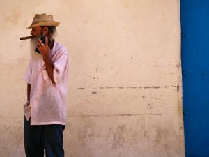 Old Man with Transistor Radio and Cigar, Havana, Havana, Cuba by Dominic Bonuccelli