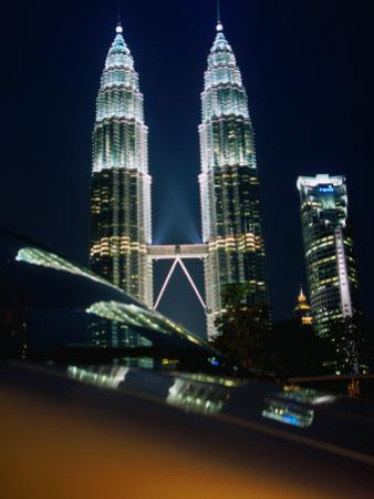 Petronas Towers at Night Reflected Off a Car Hood, Kuala Lumpur, Wilayah Persekutuan, Malaysia by Dominic Bonuccelli
