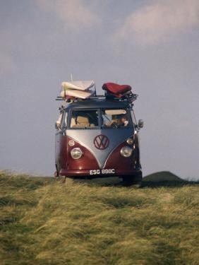 VW Camper Van with Surf Boards on Roof by Dominic Harcourt-webster