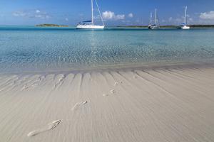 Bahamas, Exuma Island, Cays Land and Sea Park. Footprints and Sailboat by Don Paulson