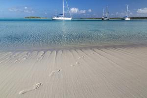 Bahamas, Exuma Island, Cays Land and Sea Park. Footprints and Sailboat by Don Paulson