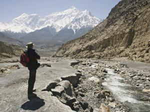 Trekker Enjoys the View on the Annapurna Circuit Trek, Jomsom, Himalayas, Nepal by Don Smith