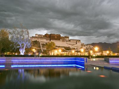 Water Feature in Front of the Potala Square Lit up with Neon Blue Lights in Early Evening, China by Don Smith