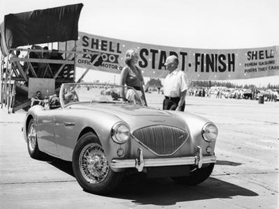 Donald Healey with an Austin Healey at a Motor Race