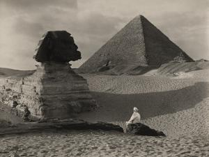 A Man Sits in Front of the Great Sphinx and Near the Cheops Pyramid by Donald Mcleish