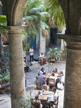 People at Tables and Musicians Playing in Courtyard of Colonial Building Built in 1780, Havana by Donald Nausbaum