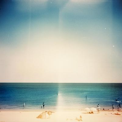 Retro Medium Format Photo. Sunny Day On The Beach. Grain, Blur Added As Vintage Effect