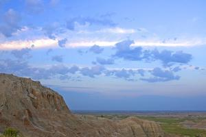 A Bighorn Sheep, Ovis Canadensis, on Ridge in Badlands National Park by Donna O'Meara