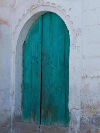 https://imgc.allpostersimages.com/img/posters/doorway-in-small-village-cappadoccia-turkey_u-L-P243BO0.jpg?p=0