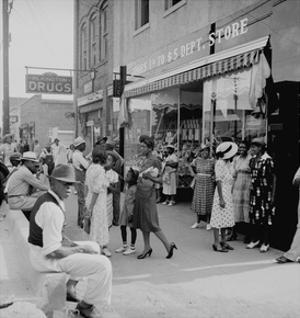 Blacks Shopping on Main Street by Dorothea Lange