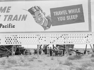 Highway billboard, 1938 by Dorothea Lange