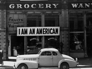 Japanese American shop owner in Oakland, CA hopes to avoid internment after Pearl Harbor, 1942 by Dorothea Lange
