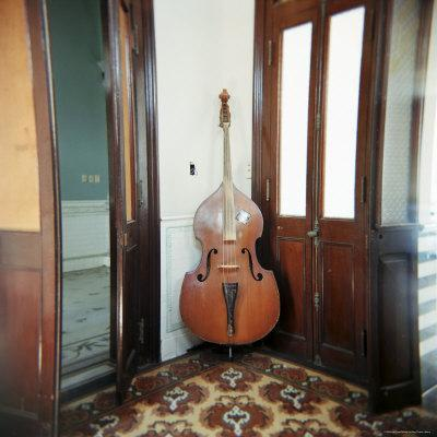 https://imgc.allpostersimages.com/img/posters/double-bass-propped-against-a-wall-cienfuegos-cuba-west-indies-central-america_u-L-P2QSU50.jpg?p=0