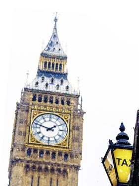 Big Ben and Taxi Sign in Snowy London, UK by Doug Armand