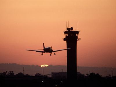 Airport Control Tower with Plane Descending, CA by Doug Mazell