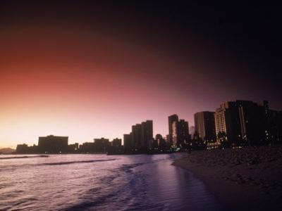 Beach and City Skyline at Sunset, HI by Doug Mazell