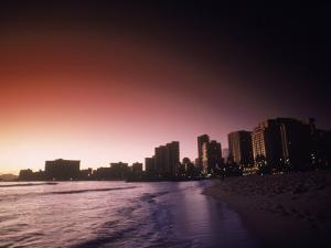 Beach and City Skyline at Sunset, HI by Doug Mazell