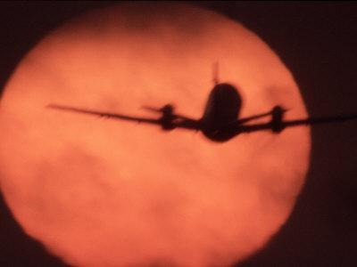 Jetliner Takeoff Framed by Sunset