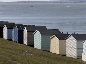 Colourful Beach Huts at the Seaside in Whitstable by Doug McKinlay