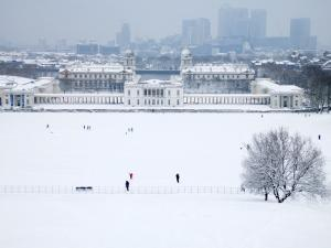 Maritime Museum, Royal Naval College and Canary Wharf Covered in Snow, from Greenwich Park by Doug McKinlay